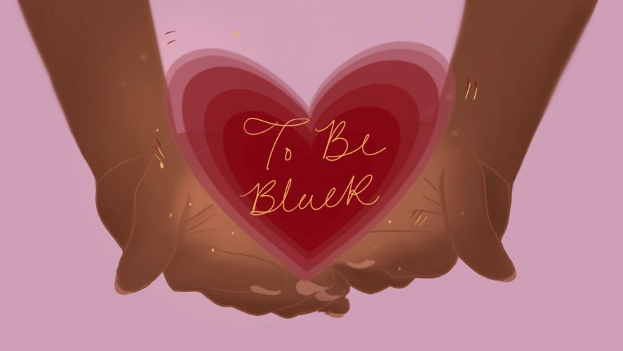 """Hands hold up a glowing heart with """"To Be Black"""" written on it in gold."""