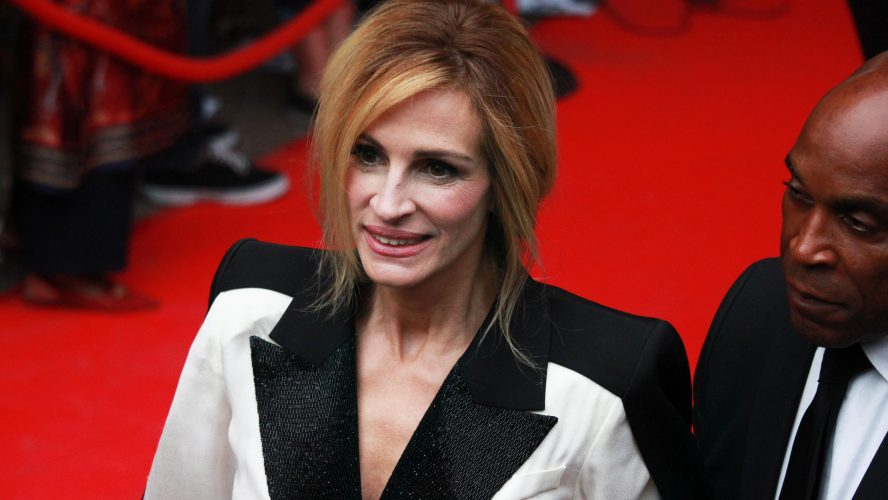 Julia Roberts smiles on red carpet at movie premiere