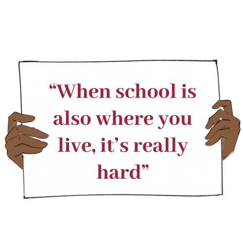 """Hands holding a sign that says a quote from the story. The quote says """"When school is also where you live, it's really hard"""""""""""