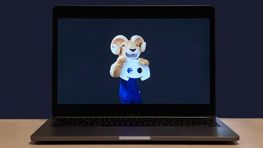A laptop showing Eggy the Ram holding the Discord logo